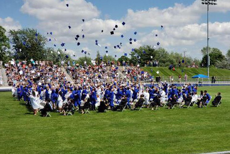 Students graduate from Adrian High School in Adrian, Michigan.