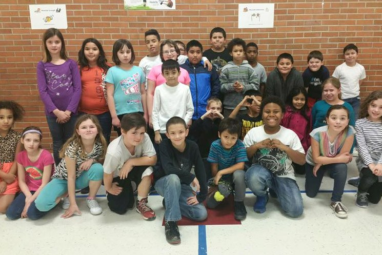 Group of school children pose as a group from Michener elementary school.